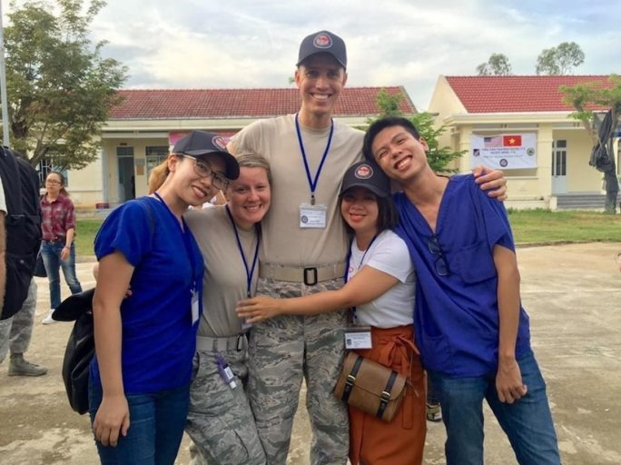 Air Force Maj. (Dr.) Cody Butler, a physical therapist and commander of the 78th Medical Group Clinical Medicine Flight, poses with other members of his engagement team in Tam Ky, Quang Nam Province, Vietnam, Nov. 30, 2017. Butler was in Vietnam as part of a team seeing patients and building relationships with local physicians during the humanitarian assistance engagement Operation Pacific Angel Vietnam 2017. Air Force photo by Jonathan Bell