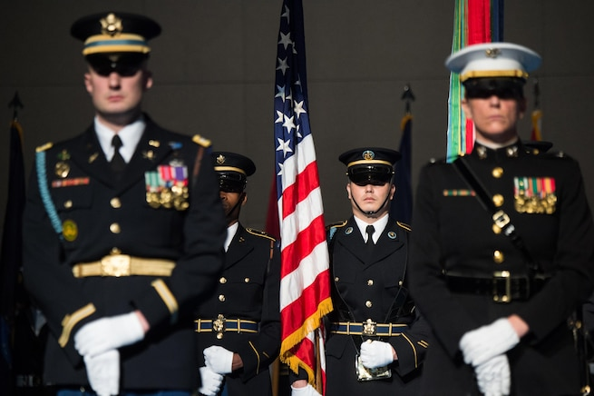 Members of the Armed Forces Honor Guard stand in formation during Defense Secretary Carter's farewell ceremony at Joint Base Myer-Henderson Hall, Va., Jan. 9, 2016. DoD photo by Army Sgt. James K. McCann