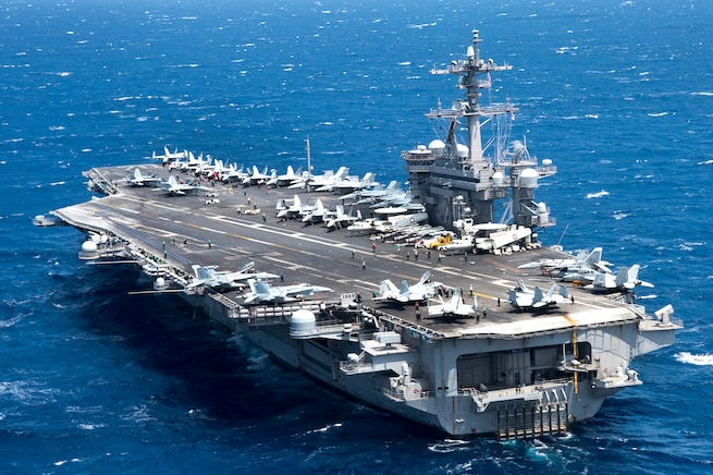 The aircraft carrier USS Carl Vinson transits the South China Sea March 2, 2017. The Carl Vinson Strike Group is deployed to the Western Pacific as part of the U.S. Pacific Fleet-led initiative to extend the command-and-control functions of U.S. 3rd Fleet. Navy photo by Petty Officer 3rd Class Kurtis A. Hatcher