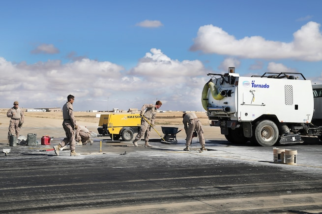 Marines maintain a runway at Al Asad Air Base, Iraq, March 4, 2017. The Marines are assigned to Task Force Al Asad. Airfield maintenance is conducted to keep the airfield safe for aircraft use and to maintain daily operations in support of Combined Joint Task Force Operation Inherent Resolve. Army photo by Sgt. Lisa Soy