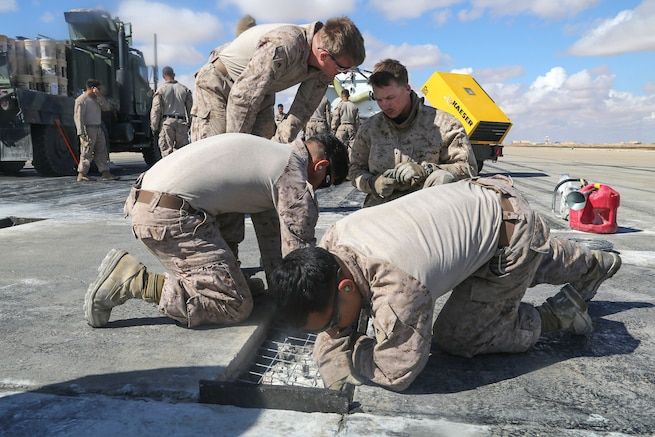 Marines prep a pothole for to be filled with concrete during maintenance on a runway at Al Asad Air Base, Iraq, March 4, 2017. Army photo by Sgt. Lisa Soy