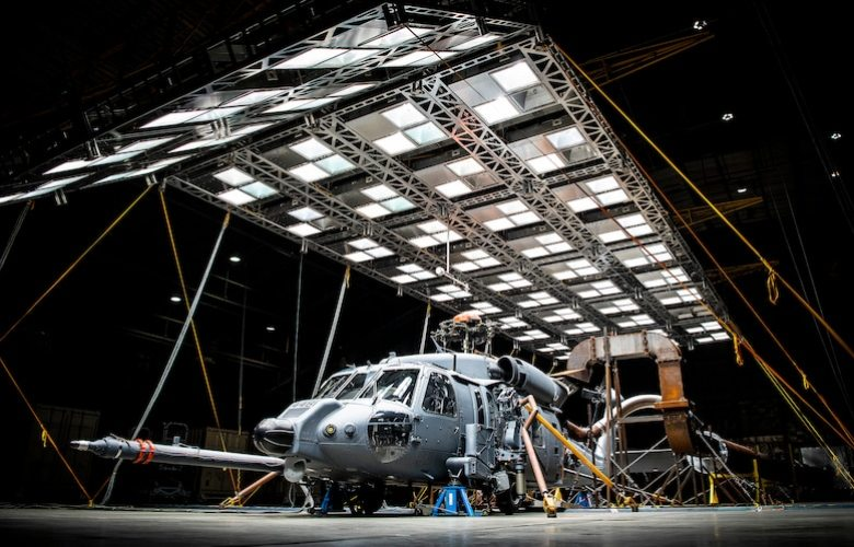 An HH-60W Jolly Green II sits under bright lights used to create heat in the McKinley Climatic Lab at Eglin Air Force Base, Fla., March 19, 2020. (U.S. Air Force photo by Samuel King Jr.)