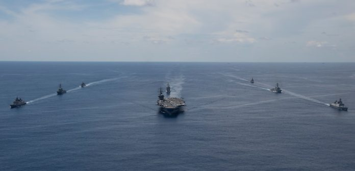 The Nimitz Carrier Strike Group, consisting of flagship USS Nimitz (CVN 68),  Ticonderoga-class guided missile cruiser USS Princeton (CG 59), and Arleigh Burke-class guided missile destroyers USS Sterett (DDG 104) and USS Ralph Johnson (DDG 114), along with Indian Navy ships Rana, Sahyadri, Shivalik and Kamorta, steam in formation during a cooperative deployment in the Indian Ocean June 20.