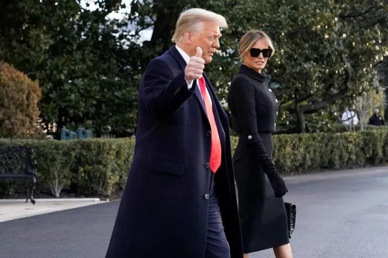 El presidente Donald Trump y la primera dama Melania Trump se dirigen hacia el Marine One en la Casa Blanca el miércoles 20 de enero del 2021 en Washington. Trump se dirige a su resort Mar-a-Lago Florida.