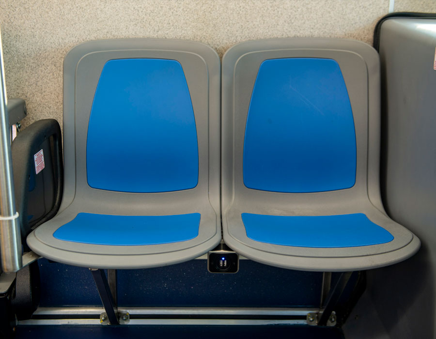 New blue seats and USB Charging Ports are coming to the new Disney Buses