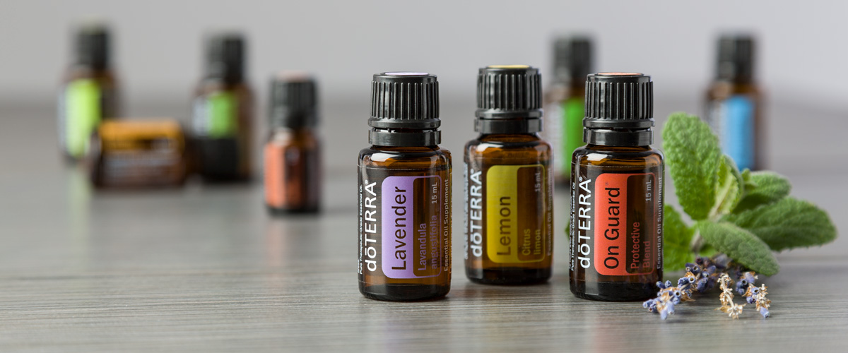 lavender lemon and on guard essential oils with indistinct essential oils in background