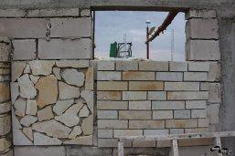 Placarea unei case cu piatră