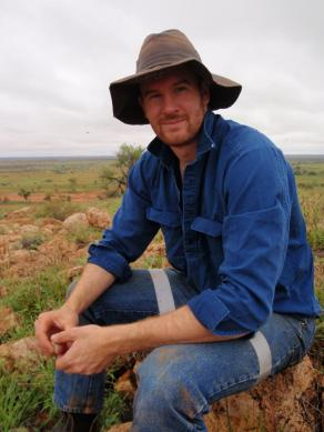 Dr Thomas Newsome in the field. Credit: Fiona Roughley/University of Sydney