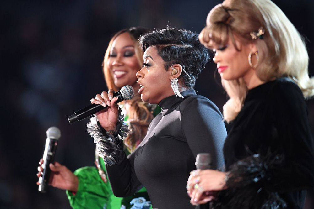 Andra Day, Fantasia and Yolanda Adams perform an Aretha Franklin tribute onstage during the 61st Annual Grammy Awards