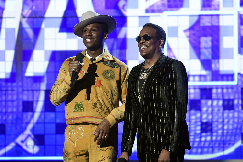 Leon Bridges (L) and Charlie Wilson speak onstage during the 61st Annual GRAMMY Awards