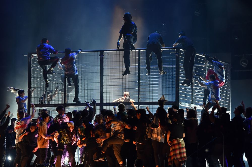 Travis Scott (C) performs onstage during the 61st Annual Grammy Awards