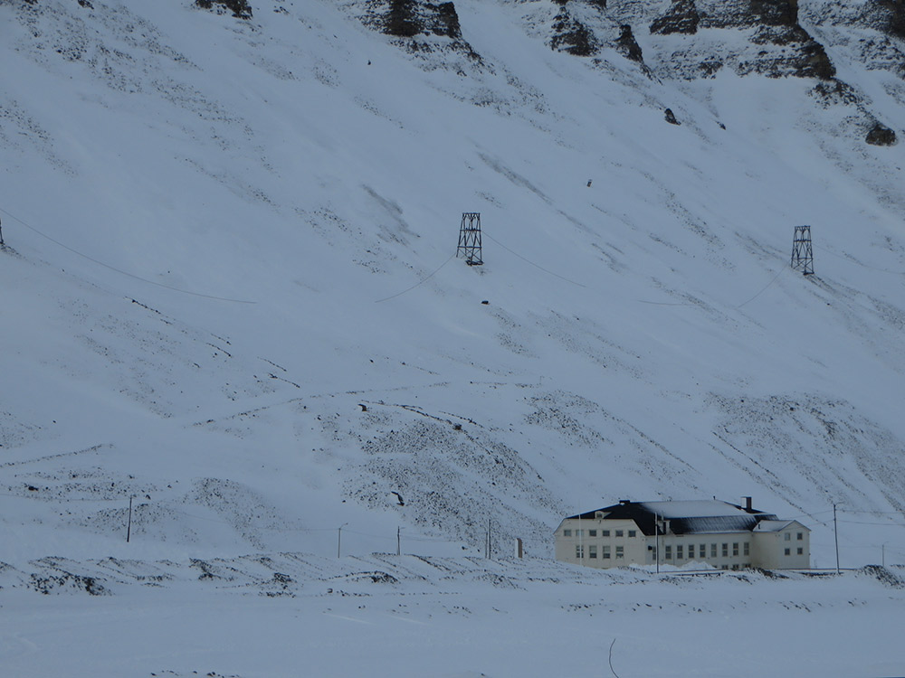 Nestled into the side of a snowy hill is one of the largest wine cellars in all of Europe. Photo courtesy Bernt R.