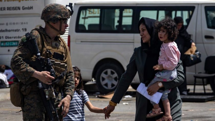 Photo provided by the US Central Command Department of Public Affairs shows a Marine directing evacuation at Hamid Karzai International Airport, Afghanistan, August 20, 2021. Illustrative image.