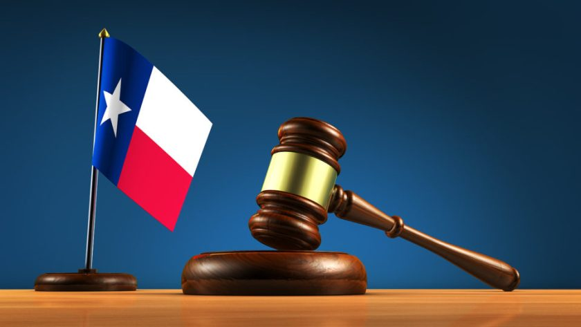 Texas state law, legal system and justice concept with a gavel and the Texan desk flag 3D illustration.