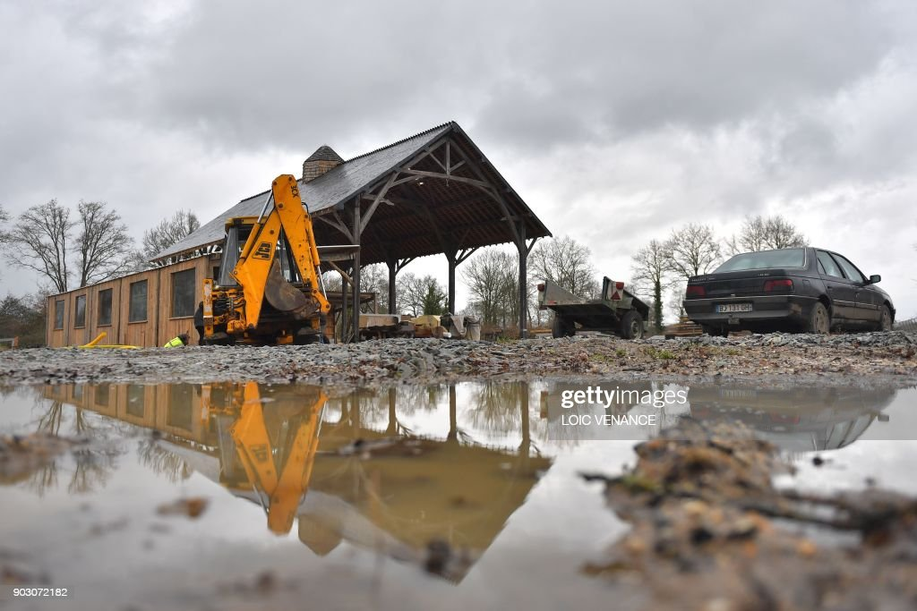 Activists build a hangar in the  zad    zone a defendre   zone to     Activists build a hangar in the  zad    zone a defendre