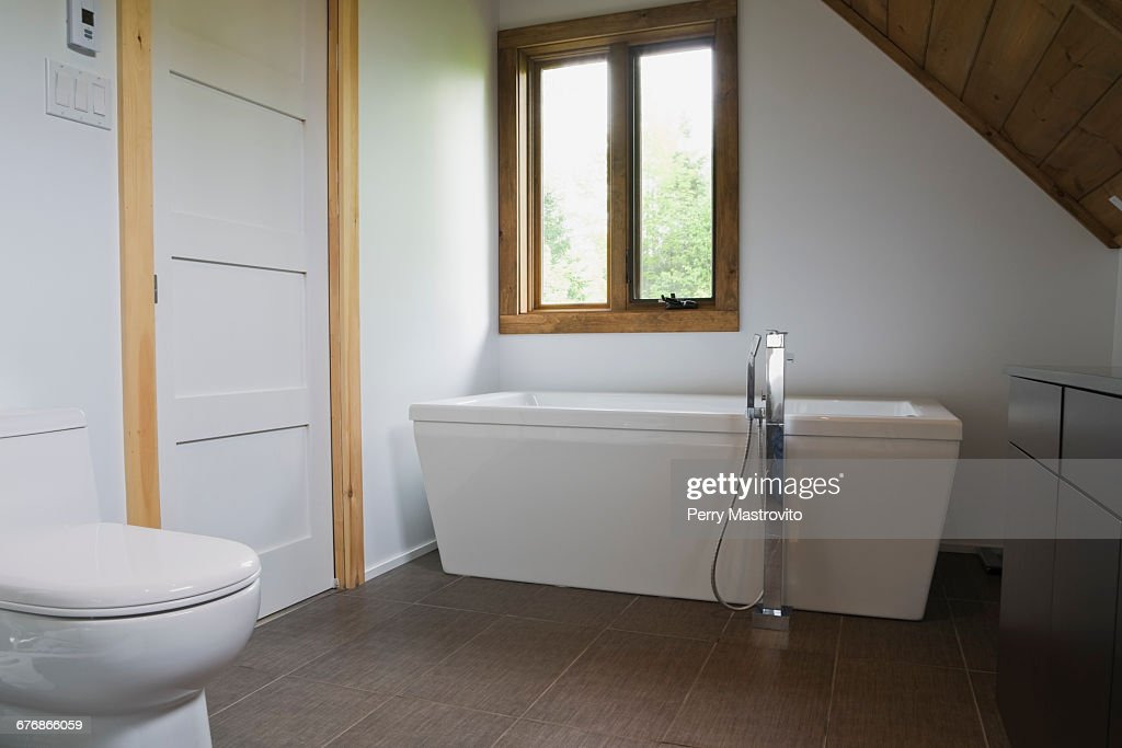 https www gettyimages com detail photo bathroom with grey ceramic tile floor and white royalty free image 676866059