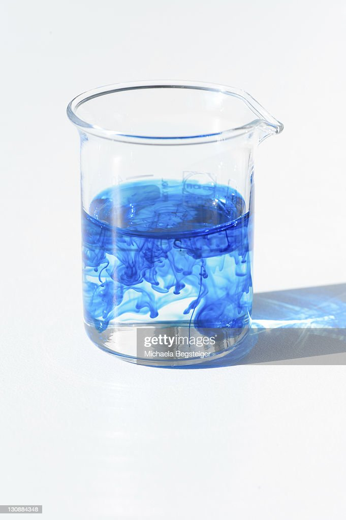 Chemistry Lab Measuring Cup Beaker Glass With Blue Food