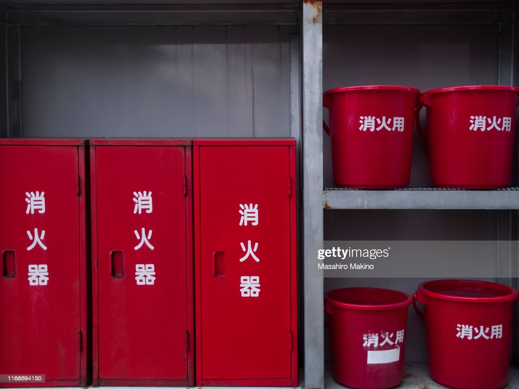 Fire Extinguisher Cabinets And Red Buckets High Res Stock