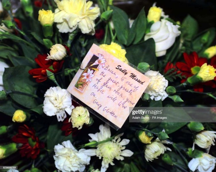 Connolly funeral flower Glitter Pictures   Getty Images Flowers from Gary Glitter sit outside the Most Holly Name Catholic Church   in Denham today