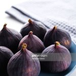Fresh Whole Purple Figs On A Ceramic Plate On A White Wooden Table Background High Res Stock Photo Getty Images