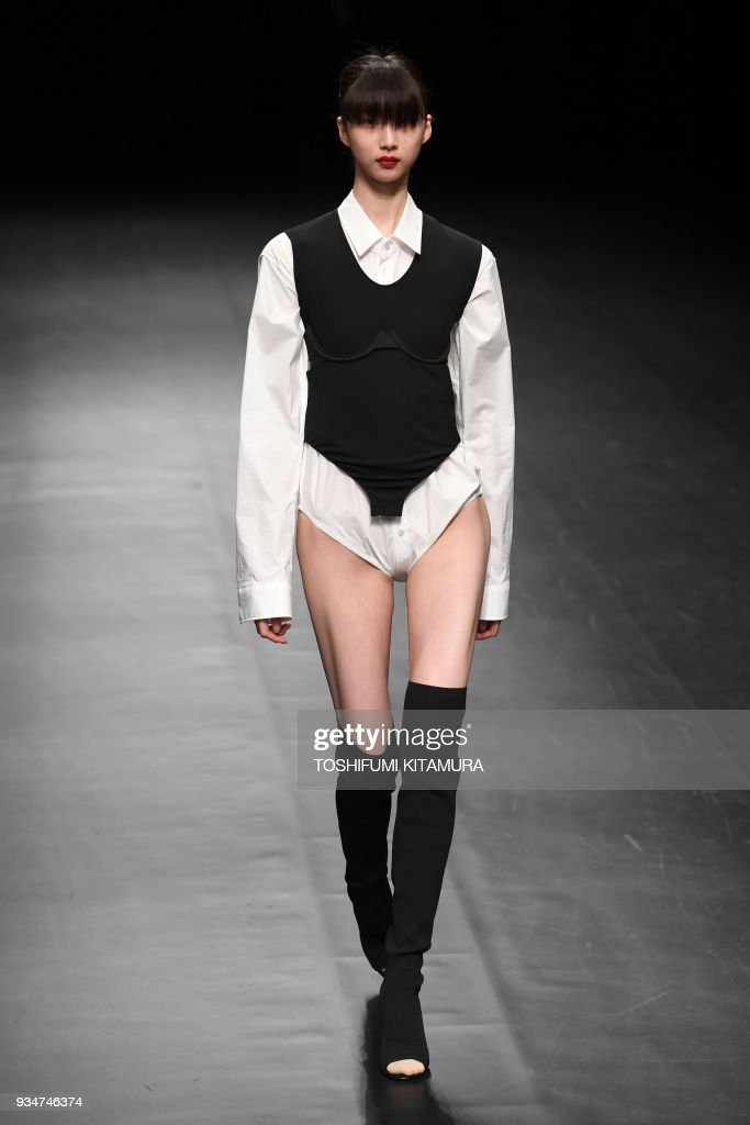 A model presents a creation by Japanese fashion brand     A model presents a creation by Japanese fashion brand DressedUndressed from  their 2018 autumn winter