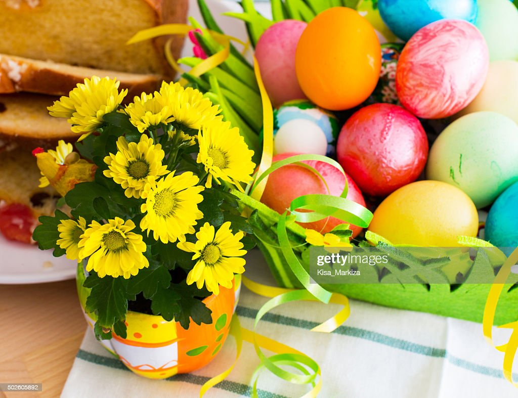 Nice Spring Yellow Flowers Easter Eggs And Traditional Holiday Cake     Nice spring yellow flowers  Easter eggs and traditional holiday cake    Stock Photo