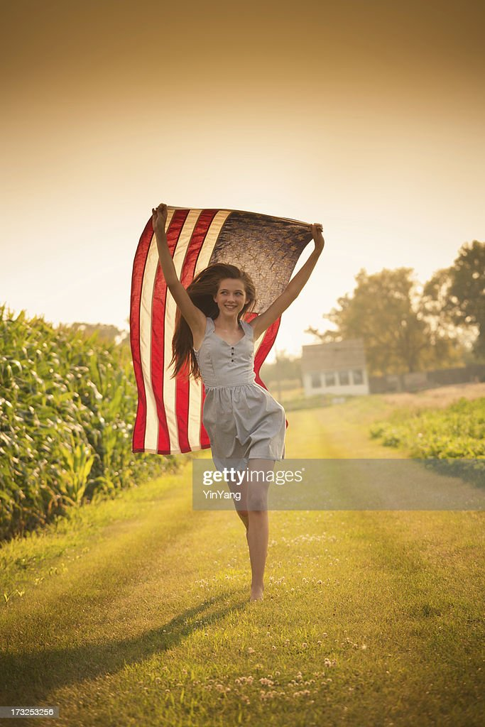 Patriotic Teen Farm Girl Running Through Field Waving Us