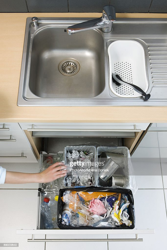 https www gettyimages com detail photo person sorting trash into home recycling bins royalty free image 89020640