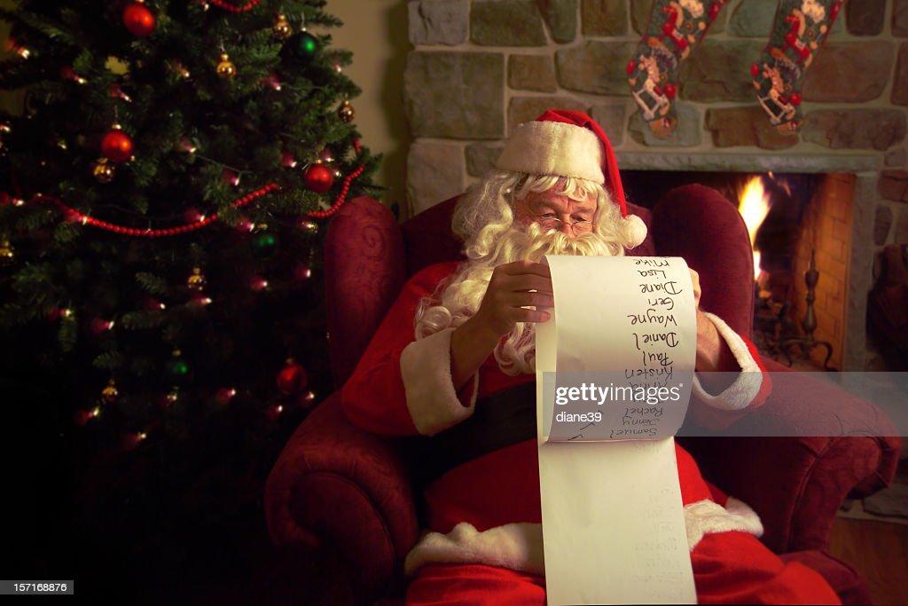 Santa Claus Checking His Christmas List Stock Photo