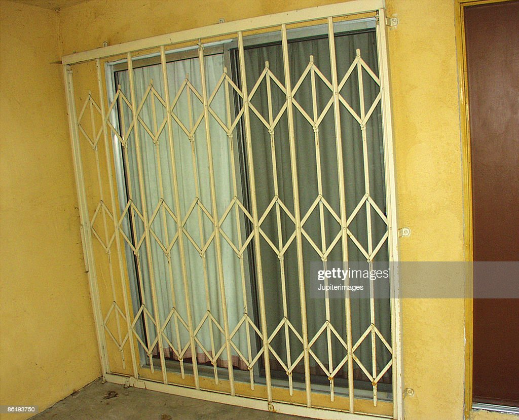 https www gettyimages com detail photo security gate across sliding glass door royalty free image 86493750