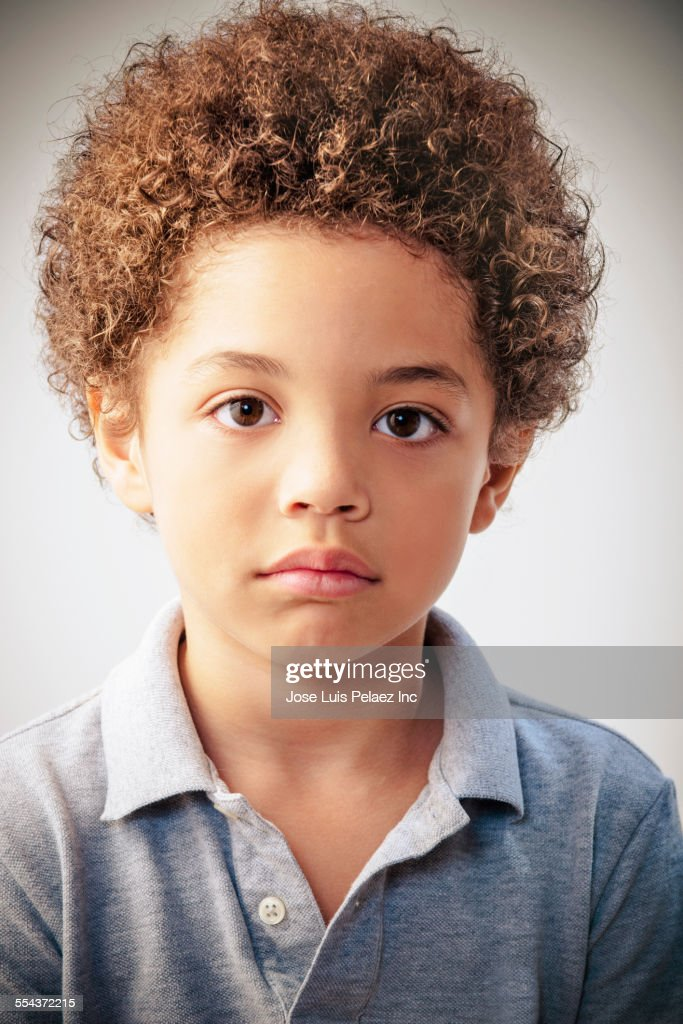 Serious Mixed Race Boy With Curly Hair Stock Photo Getty