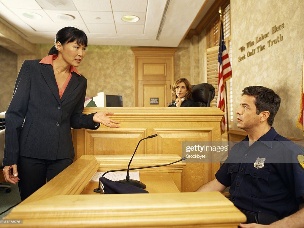 Side Profile Of A Witness And A Lawyer On The Witness
