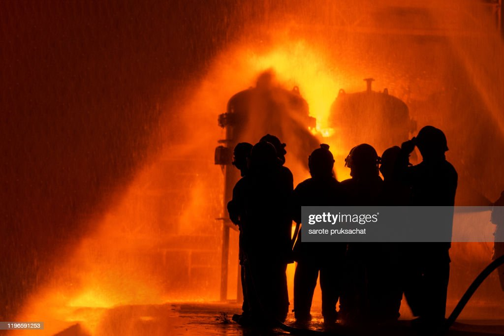 silhouette fireman training spray water curtain group of firefighters helped stop the fire fire in the industrial factory rescue education emergency and teamwork concept high res stock photo getty images