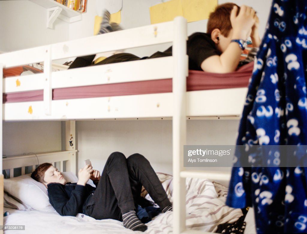 https www gettyimages com detail photo teenage brothers in bunk beds in their bedroom royalty free image 813208176