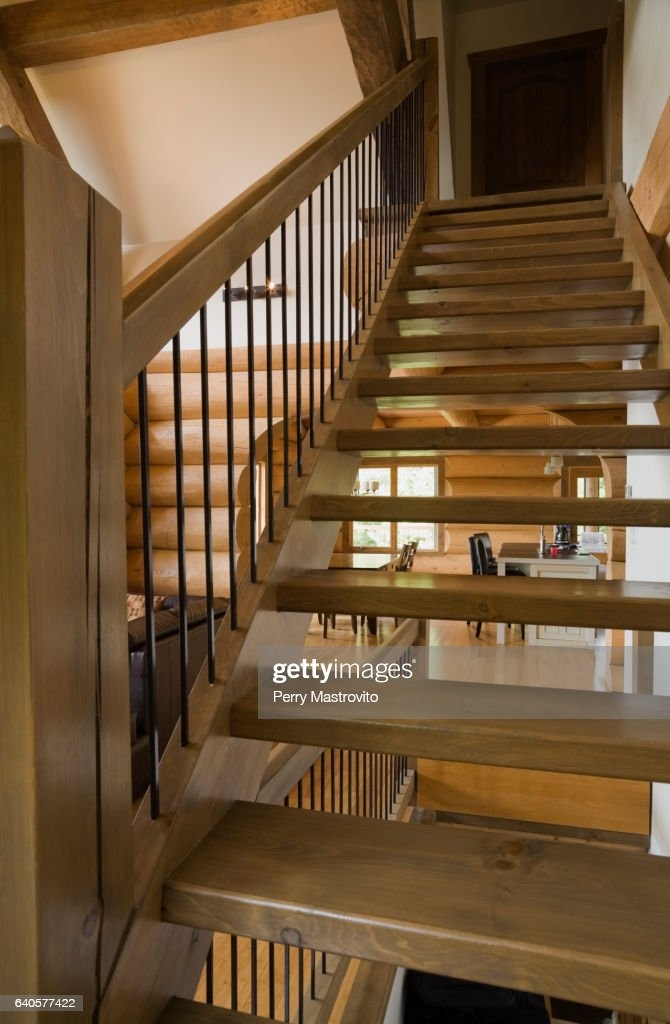 Wooden Stairs With Wrought Iron Railing High Res Stock Photo | Wood And Rod Iron Railing | Wooden | Dark Stained | Wrought Iron | Pipe | Simple Modern