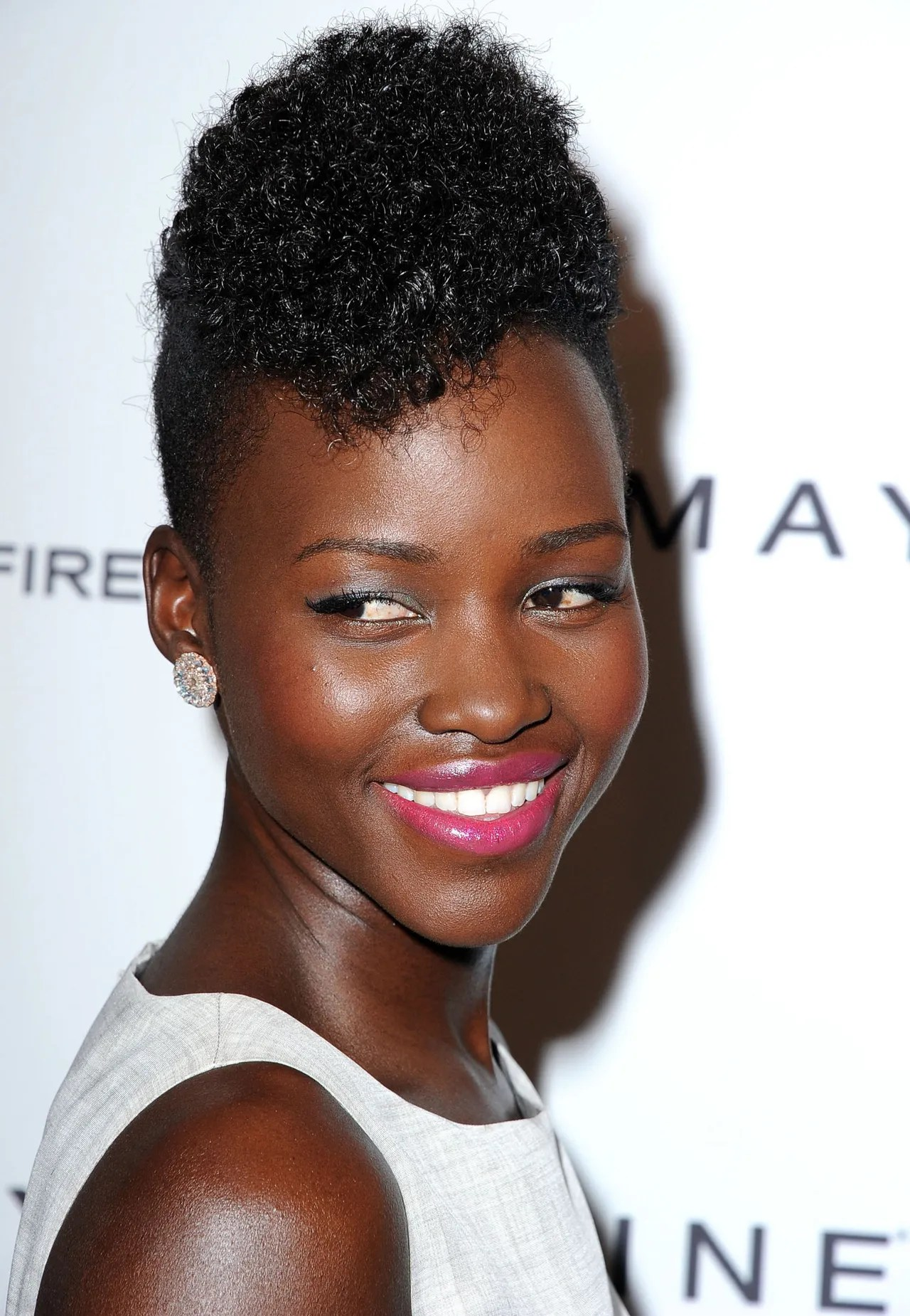 Lupita Nyong o Styles Her Hair Into a Curly Pompadour