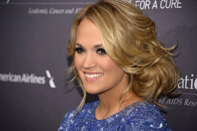 carrie underwood tries a new hairstyle, manages to up the