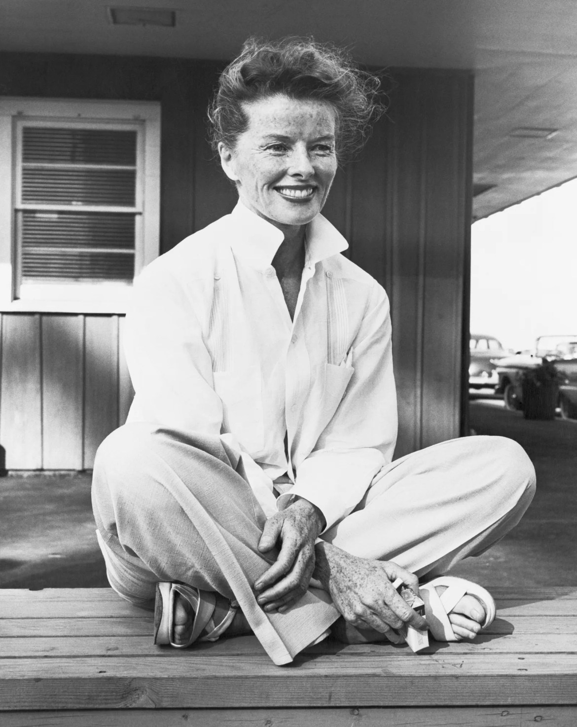 Katharine Hepburn wearing a white blouse with trousers