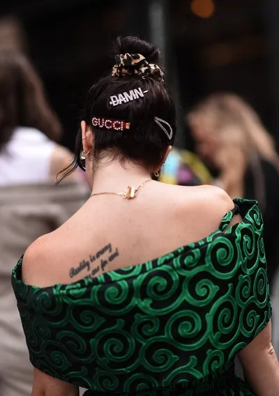 A guest is seen wearing Gucci head accessories outside the Cynthia Rowley show during New York Fashion Week SS20
