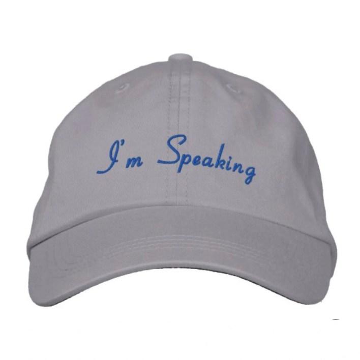 grey baseball cap with blue cursive text