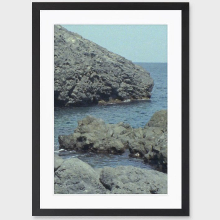 framed photo of the ocean and rocks