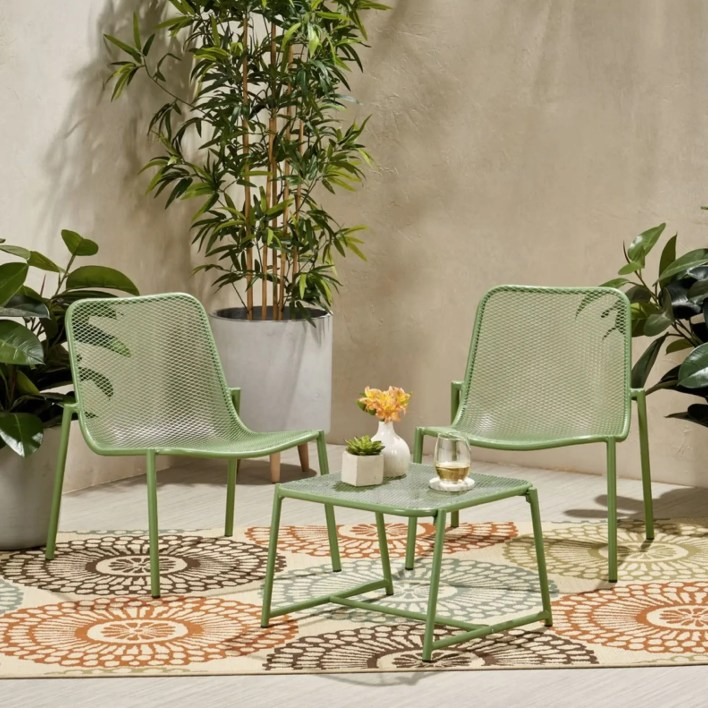 set of sage green outdoor chairs and matching table