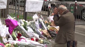 'We will never give up': Parisians pay their respects to victims of Paris attacks