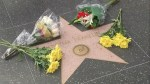 People lay flowers at Aretha Franklin's Hollywood Walk of Fame star