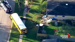 Aftermath of Chicago school bus hitting a house