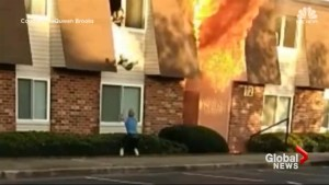 Mystery man makes incredible catch after baby tossed from burning building