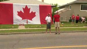 Calgary house draped in giant flag on Canada Day