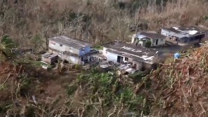 Rescue helicopter comes to aid of family in Puerto Rico after spotting 'Help' written on their roof