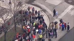 Aerial footage: thousands of teachers hit the streets as 'sick out' continues in Detroit