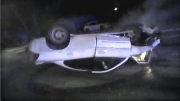 Dramatic Police Video Captures Car Crash And Rescue From Burning